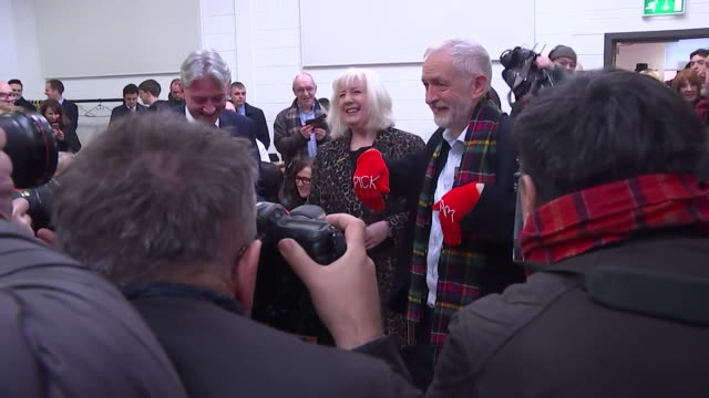 jeremy corbyn labour leader given pick me knitted gloves on election campaign trail in coatbridge scotland - gift stock videos & royalty-free footage