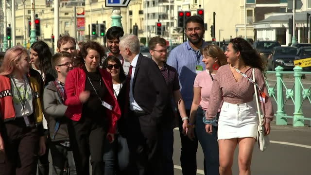 jeremy corbyn labour leader walking along brighton seafront on the first day of the labour party conference - crowded stock videos & royalty-free footage