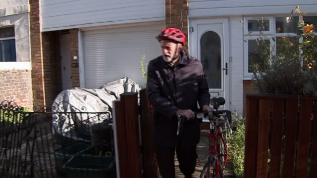 jeremy corbyn leaving his house on a bicycle - bicycle stock videos & royalty-free footage
