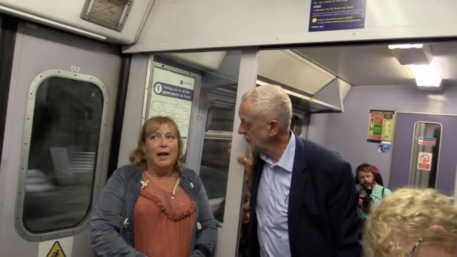 jeremy corbyn on a northern rail train from manchester victoria to leeds he speaks to passenger patricia russell who was on the train with jane... - jeremy corbyn stock videos & royalty-free footage