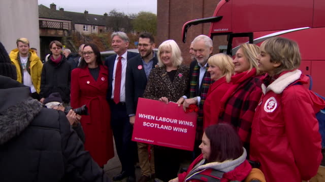 jeremy corbyn on election campaign trail in coatbridge scotland holds sign that says when labour wins scotland wins - mp stock videos & royalty-free footage