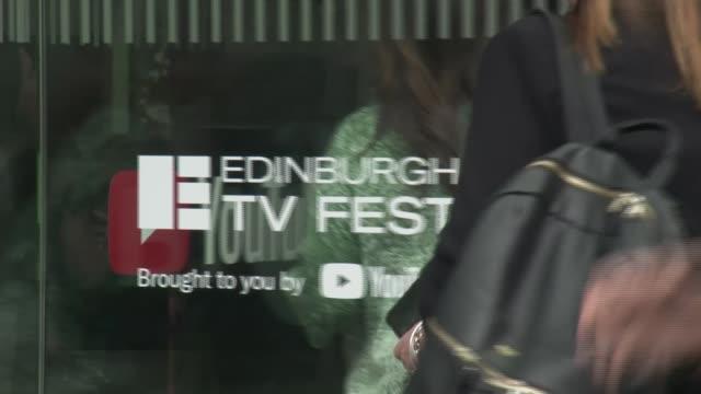 jeremy corbyn proposes 'tech tax' to fund journalism scotland edinburgh ext people along through revolving door - edinburgh stock videos and b-roll footage