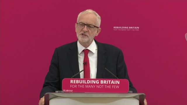 Jeremy Corbyn speech on 'Rebuilding Britain' in Corby ENGLAND Northamptonshire Corby INT Jeremy Corbyn MP arriving on stage and shaking hands with...