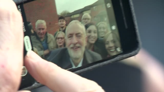 jeremy corbyn taking selfie with supporters whilst doorstep campaigning for labour for the general election - wireless technology stock videos & royalty-free footage