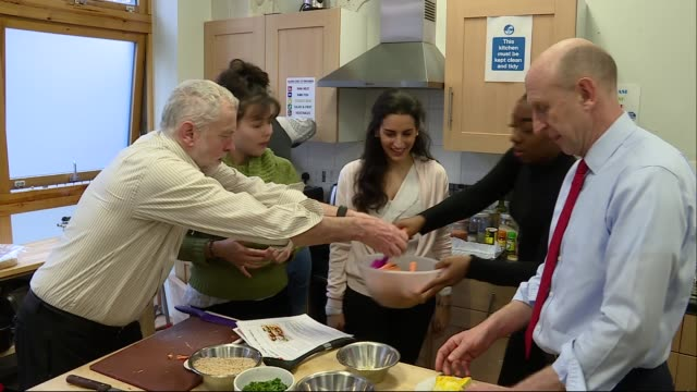 jeremy corbyn visits centrepoint; england: london: lambeth: int jeremy corbyn mp and john healey mp towards into kitchen / jeremy corbyn making... - trivia stock videos & royalty-free footage