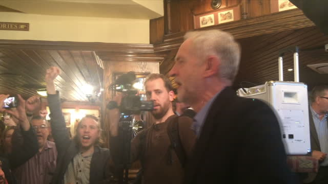 Jeremy Corbyn voted next Labour leader Shows Jeremy Corbyn and supporters signing 'The Red Flag' in a pub after victory