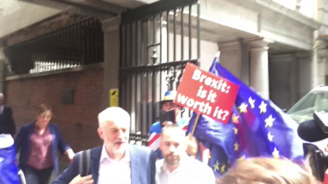 jeremy corbyn walking past anti-brexit protestors and reporters asking him about the labour party anti-semitism row - rebellion stock videos & royalty-free footage