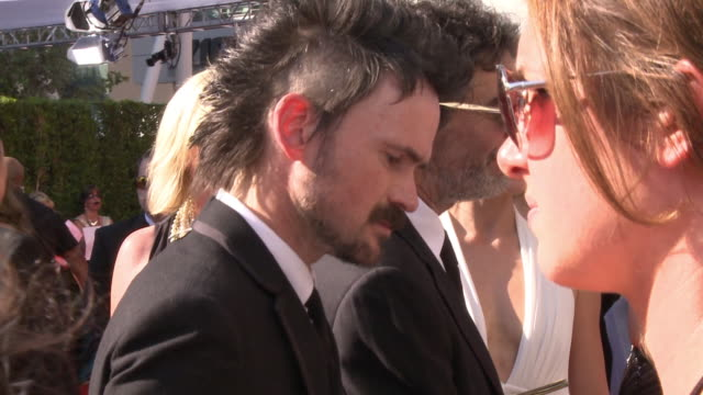 Jeremy Davies talking to reporter on crowded red carpet at the Nokia Theater Live LA