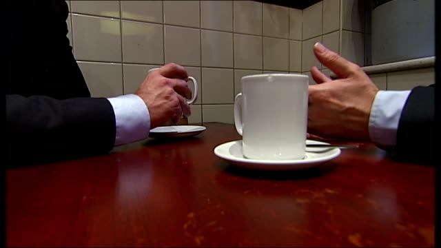 jeremy heywood appointed new cabinet secretary int lord lamont interview sot whitehall pan to cafe int close shot tea cups on table general view of... - jeremy heywood stock videos & royalty-free footage