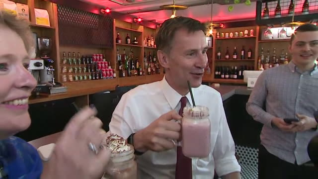 jeremy hunt conservative leadership candidate posing with milkshake and local mp vicky ford in chelmsford - drink stock videos & royalty-free footage
