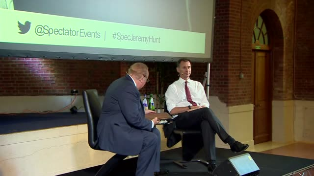 jeremy hunt in conversation with andrew neil; uk, london, westminster: jeremy hunt and andrew neil along to stage and introductory statement.... - andrew neil stock videos & royalty-free footage