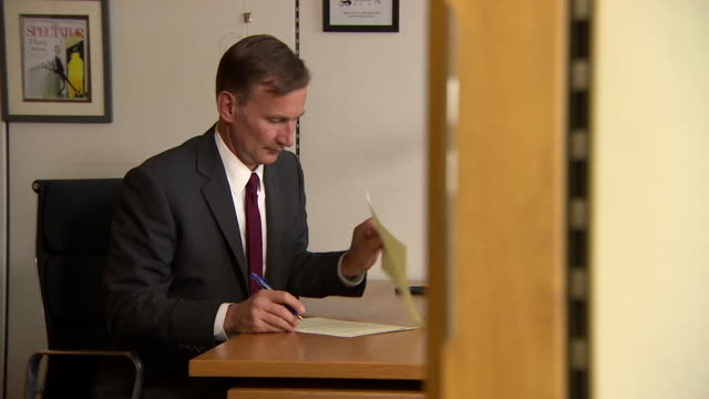 jeremy hunt mp sat at desk signing letter to eu about brexit negotiations london - writing stock videos & royalty-free footage