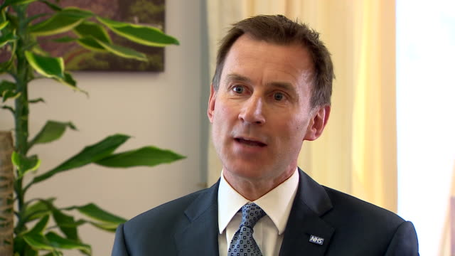 """jeremy hunt saying there is a criminal investigation underway """"to find out exactly why they targeted who they did"""" but says it is also an... - 国民保険サービス点の映像素材/bロール"""