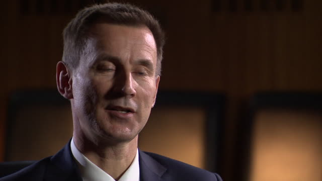 vídeos de stock e filmes b-roll de jeremy hunt talks about increasing pressures on the nhs including flu and an ageing population saying that the present government is 'proud of the... - sns