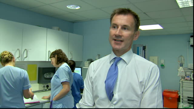 jeremy hunt visits king's college hospital jeremy hunt mp interview sot / hunt and hospital worker through doors using hand sanitizer gel and along... - hand sanitizer stock videos and b-roll footage