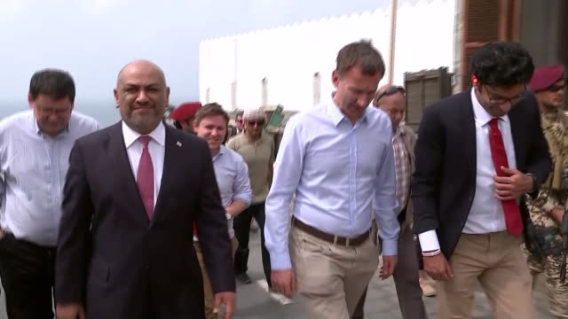 jeremy hunt visits yemen; yemen: aden: ext jeremy hunt greeted by khaled al yamani and being shown aden - aden stock videos & royalty-free footage