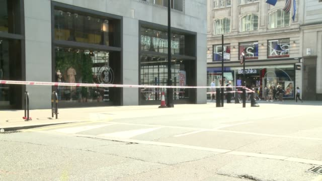 three men held england london oxford street ext police officer standing next to taped off area close to the scene of the stabbing to death of jeremy... - crime and murder stock videos & royalty-free footage