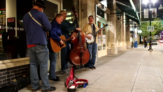 jeremy phillips lynn swanson mark movic and tom riehl from the ortonville circus band play bluegrass music on the street on october 09 2019 in des... - bluegrass music stock videos and b-roll footage