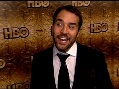 HANDHELD Jeremy Piven standing on carpet in Beverly Hilton hotel posing for camera joking around w/ someone off screen