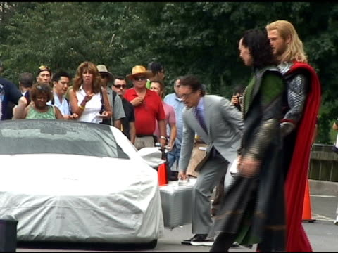 Jeremy Renner and Scarlett Johansson relax on the set of 'The Avengers' in Central Park in New York 09/02/11
