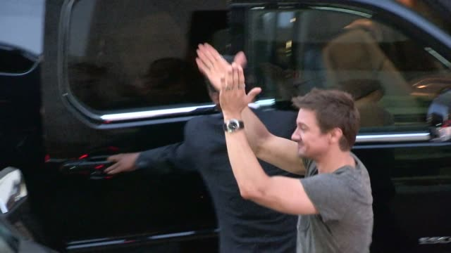 Jeremy Renner exchanges greetings with fans while departing the 2014 Comic Con Panel in San Diego in Celebrity Sightings in San Diego