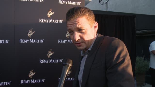 jeremy renner on why he chose to partner with remy martin, on if this is his first brand partnership, on how the remy martin campaign at rémy martin... - wap stock videos & royalty-free footage
