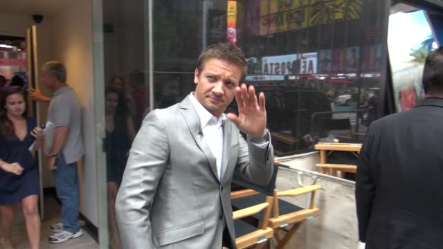 Jeremy Renner walking to the outside set of Good Morning America in New York 07/30/12