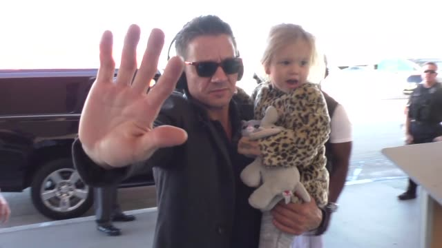 Jeremy Renner with his daughter departing at LAX Airport in Los Angeles in Celebrity Sightings in Los Angeles