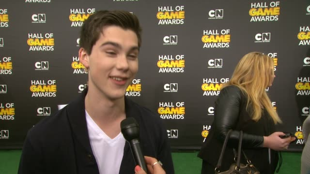 interview jeremy shada on the event on seeing colin kaepernick and cam newton on his favorite sports and on cartoons at cartoon network hosts fourth... - barker hangar stock-videos und b-roll-filmmaterial
