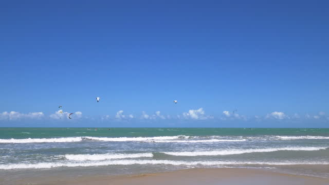 jericoacoara beach full of kite surfers in the water, fortaleza, ceara, brazil - sand dune stock videos & royalty-free footage