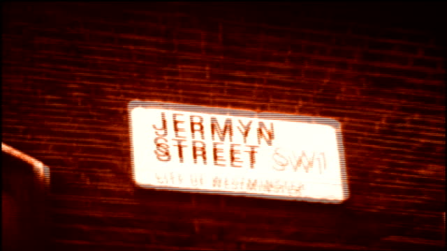 jermyn st road sign with red film effect in london - road sign stock videos & royalty-free footage