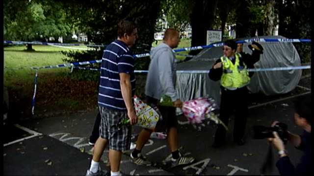 police wait to question suspect; channel islands: jersey: st helier: ext people along with floral tributes armed police officers getting out of... - road closed sign stock videos & royalty-free footage