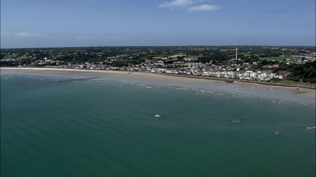 jersey,  st aubins bay - aerial view - helicopter filming,  aerial video,  cineflex,  establishing shot - channel islands england stock videos & royalty-free footage