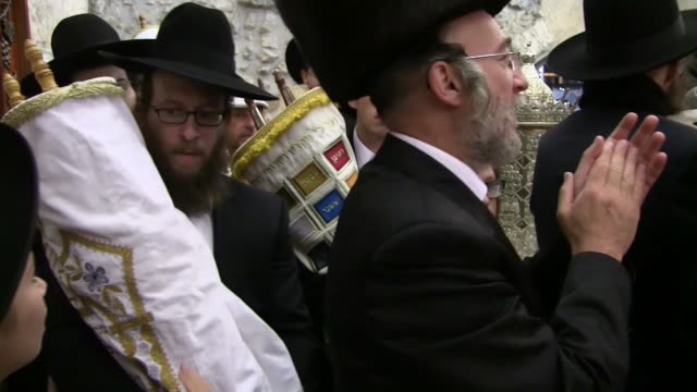 jerusalem 24th october 2016 religious jews dancing with scrolls of torah as they celebrate the simchat torah a jewish holiday that celebrates and... - torah stock videos and b-roll footage