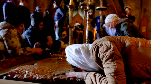 jerusalem, church of the holy sepulchre- stone of the anointing / jerusalem old city - crucified females stock videos & royalty-free footage