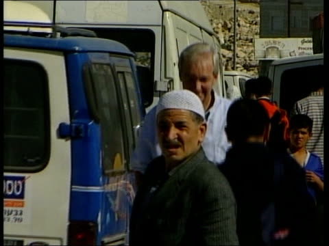 jerusalem ext tms cars queuing at israeli checkpoint soldier checking papers of an arab man soldiers manning checkpoint arab women having papers... - arab israeli conflict stock videos & royalty-free footage