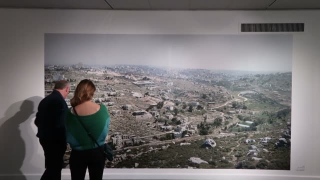 jerusalem israel, 01 february 2019. israeli visitors looking at the work of israeli photographer and artist yaakov israel entitled 'legitimacy of... - eddie gerald stock videos & royalty-free footage