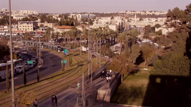 w7s jerusalem light rail - tram arriving in front of old city - jerusalem old city stock videos and b-roll footage