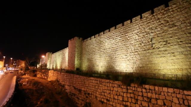 jerusalem, night shot of the ottoman walls - jerusalem old city stock videos and b-roll footage