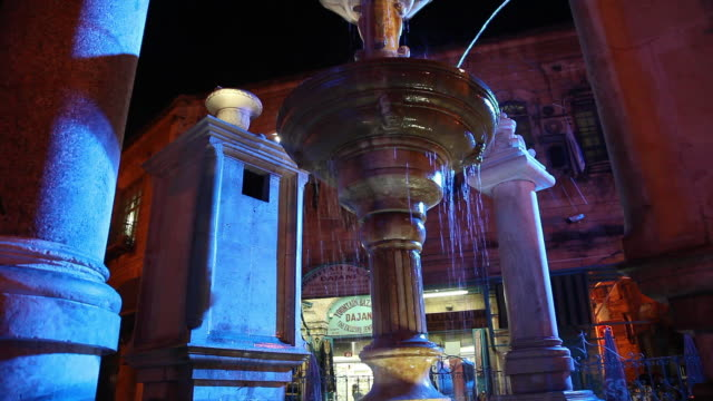 jerusalem, the muristan fountain in the christian quarter - ヴィアドロローサ点の映像素材/bロール
