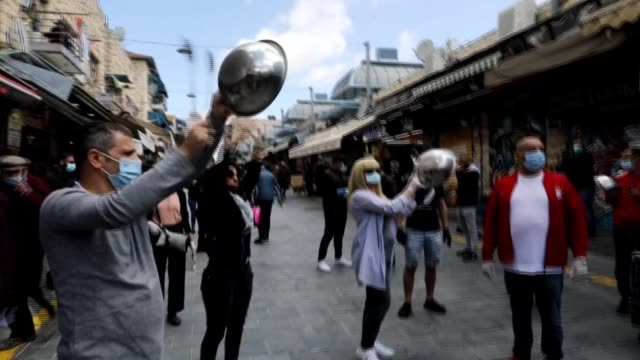 jerusalem's mahane yehuda shop owners demonstrate banging pots and pans demanding the reopening of their businesses after the israeli government... - cooking pan stock videos & royalty-free footage