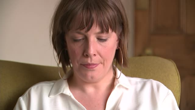 birmingham int jess phillips mp set up shots on mobile phone / interview sot - west midlands stock-videos und b-roll-filmmaterial