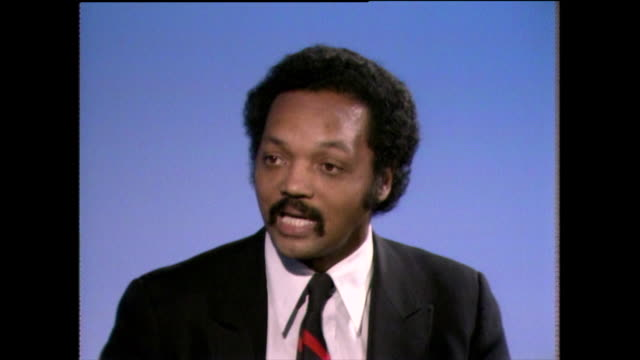 jesse jackson feels that nonviolent protest and action is an effective method to achieve results compared to 'violent revolts' which the opposition... - shirt and tie stock videos & royalty-free footage