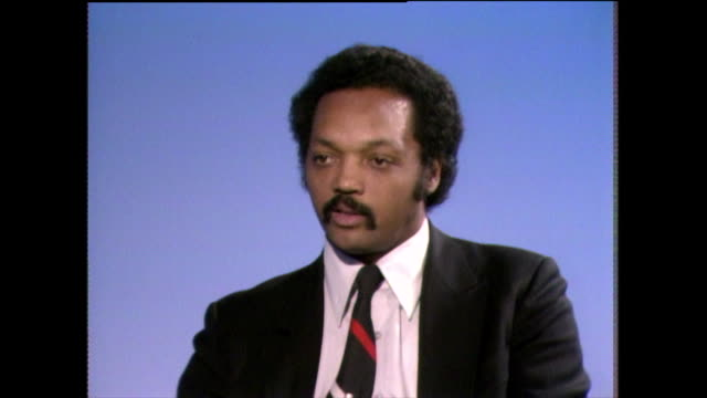 jesse jackson speaks about balancing time spent protesting alongside his religious obligations and explains how he feels they are all part of his... - shirt and tie stock videos & royalty-free footage