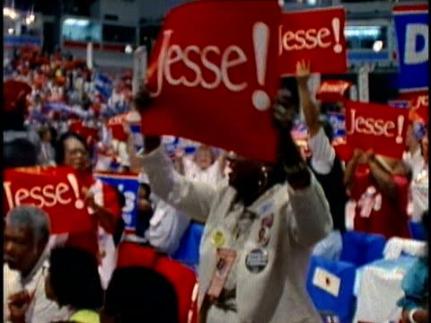 vídeos de stock e filmes b-roll de jesse jackson supporters holding signs at democratic national convention in july 1988 / atlanta, georgia, usa - ponto de exclamação