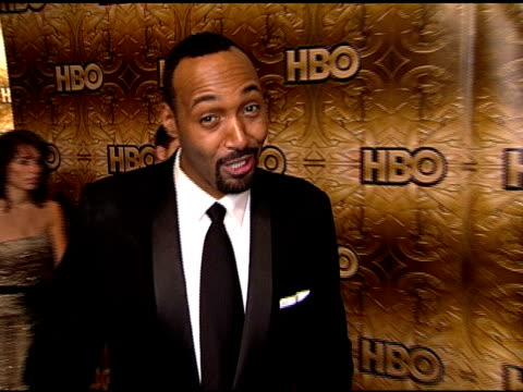 HANDHELD Jesse L Martin standing on carpet in Beverly Hilton hotel posing for camera waving