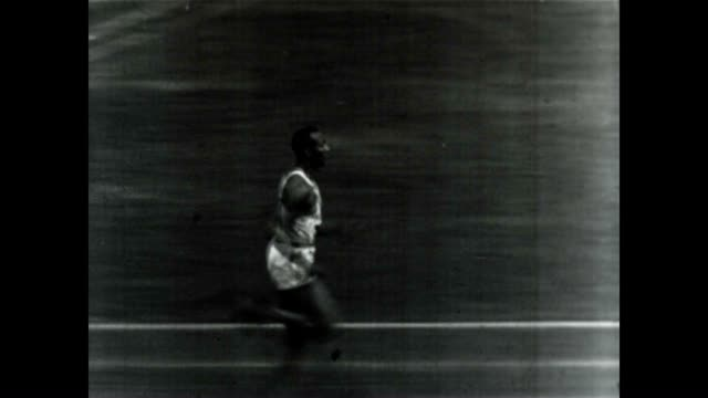 jesse owens, at the 1936 berlin olympics. he would win four gold medals. - アメリカ黒人の歴史点の映像素材/bロール