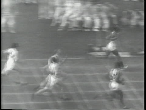jesse owens races in the 100 meter race during the 1936 olympic games - sport stock-videos und b-roll-filmmaterial