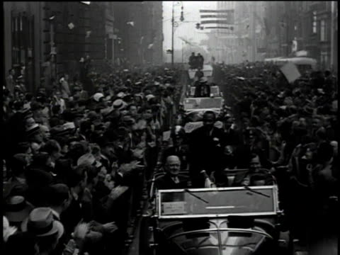 jesse owens sits on top of a convertible during the olympic homecoming parade / new york city, new york, united states - 1936 stock videos & royalty-free footage