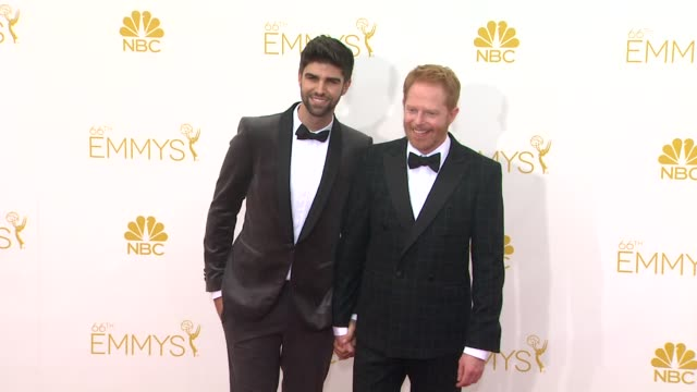 Jesse Tyler Ferguson and Justin Mikita 66th Primetime Emmy Awards Arrivals at Nokia Theatre LA Live on August 25 2014 in Los Angeles California